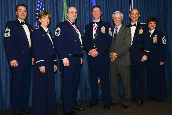 "Fairchild leadership and Retired Lt. Col. Barry Bridger, a survivor of the ""Hanoi Hilton"" prison camp in Vietnam, pose for a photo with the newly selected Chief Master Sgts. Chad Madore and Shane Sweeney during the Chief Recognition Ceremony Mar. 25, 2017, at Fairchild Air Force Base, Washington. The ceremony consisted of a medallion and a candle lighting ceremony where they lit nine candles that represented each enlisted grade in the Air Force. (U.S. Air Force photo/Senior Airman Janelle Patiño)"
