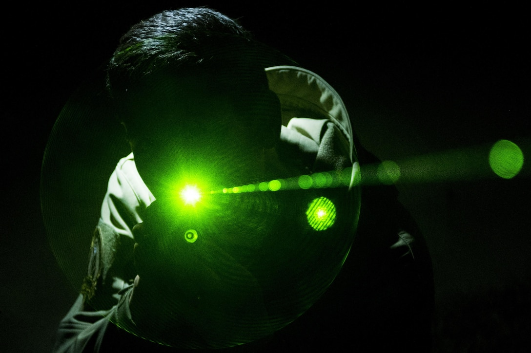 According to the Federal Aviation Administration, sudden exposure to laser radiation during a critical phase of flight can distract or disorient a pilot and cause temporary visual impairment. In the United States, lasing an aircraft is a crime under the Code of Federal Aviation Regulations 14 CFR 91.11, which prohibits interfering with a flight crew operating an aircraft, with penalties up to $11,000 per violation for anyone deliberately shining a laser at an aircraft. (U.S. Air Force photo by Airman Shawna L. Keyes)
