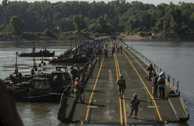 Marines with Bridge Company, 8th Engineer Support Battalion, Bridge Co. Bravo, 6th ESB and U.S. Army soldiers with 814th Multi-Roll Bridge Co. begin allowing vehicles to cross the continuous span bridge during Exercise River Assault on Fort Chaffee, July 19, 2016. The Marines spent two weeks operating Mk3 bridge erection boats and practicing connecting IRBs in preparation for the final exercise, which was a continuous IRB spanned across the Arkansas River. (U.S. Marine Corps photo by Cpl. Justin T. Updegraff)