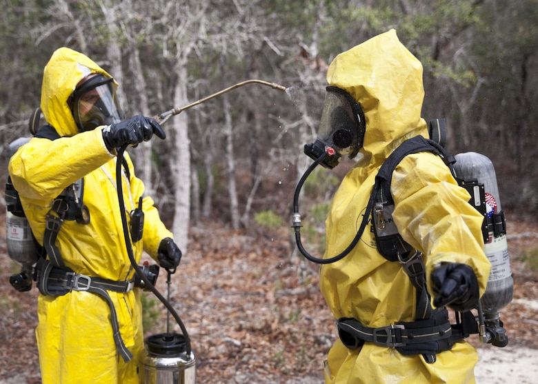 U.S. service members attending Naval School Explosive Ordnance Disposal (NAVSCOLEOD) conduct chemical biological handling of hazardous materials and decontamination during a simulated cave training exercise at Eglin Air Force Base, Fla., March 8, 2017. The purpose of NAVSCOLEOD is to train technicians in basic, as well as advanced, courses to perform various duties that include locating, identifying, rendering safe, and disposing of bombs and other hazardous materials. (U.S. Marine Corps photo by Cpl. Laura Mercado)