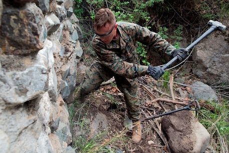 U.S. Marine Lance Cpl. Devin Schmidt, a combat engineer with 7th Engineer Support Battalion, 1st Marine Logistics Group, swings his sledgehammer at one of the dams being demolished at Cleveland National Forest in Silverado, Calif., to make a hole for an explosive on March 21, 2017. There are over 30 dams along streams in the Trabuco, Holy Jim and Silverado Canyons that will be demolished over the next two years. (U.S. Marine Corps photo by Lance Cpl. Adam Dublinske)