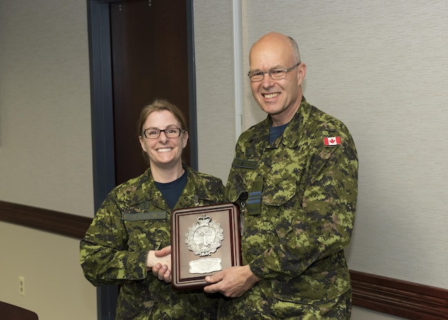 """MAJ Mike Adamczyk, command chaplain, receives a retirement plague from the Canadian Armed Forces Chaplain Branch. The NORAD and USNORTHCOM Office of the Command Chaplain at held a religious affairs workshop titled  """"Embracing Complexity-Navigating Uncertainty"""" March 23, 2017. The three-day event focused on strengthening relationships and interoperability with military mission partners. Attendees included the National Guard, National Guard Bureau, the Royal Bahamas Defence Force Command Chaplain, Canadian Armed Forces Chaplain General Representative, NORAD & USNORTHCOM Region, and Component and Subordinate Command Chaplains."""