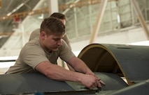 Senior Airman Shane Vandevelde, 5th Maintenance Squadron crew chief, closes an upper wrap cowling at Minot Air Force Base, N.D., March 20, 2017. During a phase inspection for 18 consecutive days, these maintainers wash, lubricate, inspect and fix all identified discrepancies on the B-52H Stratofortress. (U.S. Air Force photo/Airman 1st Class Jonathan McElderry)