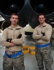 (From left) Airman 1st Class Zachary Campfield and A1C Nicholas Beltz, 5th Maintenance Squadron crew chiefs, stand in front of two B-52H Stratofortress engines at Minot Air Force Base, N.D., March 23, 2017. The crew chiefs coordinate and perform aircraft maintenance to ensure all components are functioning properly. (U.S. Air Force photo/Airman 1st Class Jonathan McElderry)