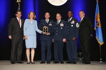 Lt. Col. Scott, former 432nd Operations Support Squadron commander, accepts the inaugural Jimmy Doolittle Educational Fellow for Outstanding Support to Armed UAVs March 2, 2017, at the Martin H. Harris Chapter of the Air Force Association Air Force Gala banquet in Orlando, Florida. Acting Secretary of the Air Force, Lisa Disbrow, presented the award alongside, from left, Air Force Gala Chairman Michael Liquori, Chief of Staff of the Air Force Gen. David Goldfein, Chief Master Sgt. of the Air Force Kaleth Wright and Martin H. Harris Chapter President Gary Lehmann. (Courtesy Photo)