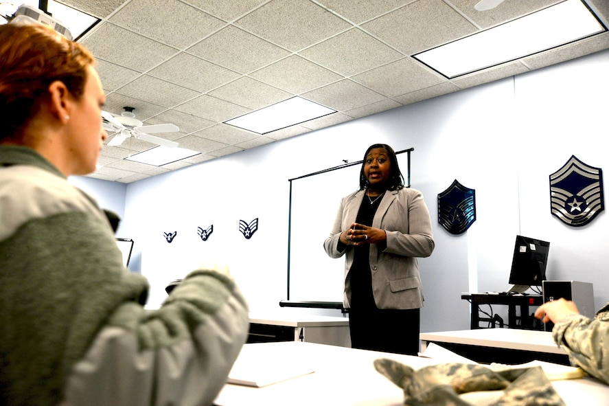 Simone White, 55th Force Support Squadron testing technician, instructs Team Offutt members on their roles and responsibilities as unit Weighted Airman Promotion System (WAPS) monitors. These include publicizing availability of the WAPS Catalog; assisting unit Airmen in identifying reference requirements; and obtaining study reference materials. Annually, Offutt's education center manages notifications, allocations and confirmations for more than 900 Team Offutt military members' professional military education, upgrade training and retraining in addition to the more than 2,000 Weighted Airman Promotion System tests they administered in fiscal year 2016.