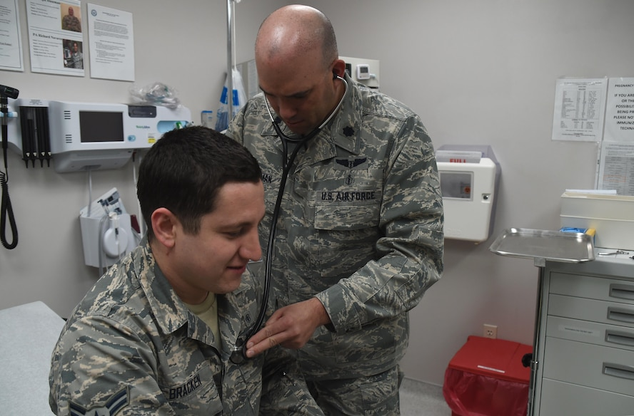 Lt. Col. (Dr.) Joseph Huseman, 21st Medical Squadron Aerospace Medicine Flight commander, checks the heartbeat of Airman 1st Class Lucas Bracken, 21 MDS, at the Schriever clinic March 23, 2017. March 30 is National Doctors' Day, which is an opportunity to celebrate those who've dedicated their lives to healthcare. (U.S. Air Force photo/Senior Airman Arielle Vasquez)