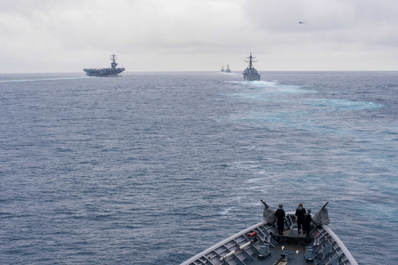 The guided missile cruiser USS Princeton sails behind the aircraft carrier USS Nimitz, left, and guided missile destroyers USS Shoup, USS Howard and USS Pinckney during a straits transit exercise while underway for a composite training unit exercise. Navy photo by Seaman Kelsey J. Hockenberger
