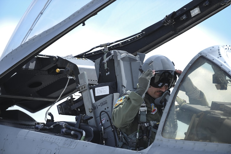 U.S. Air Force Capt. Chad Rudolph, 357th Fighter Squadron and A-10 West Heritage Flight Team pilot, puts on his goggles before takeoff during the Los Angeles County Air Show in Lancaster, Calif., March 25, 2017. This is the team's first air show performance after nearly five years of disbandment. (U.S. Air Force photo by Airman 1st Class Mya M. Crosby)