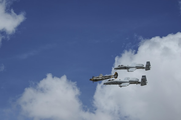 Two U.S. Air Force A-10C Thunderbolt IIs, assigned to the 354th Fighter Squadron and a part of the A-10 West Heritage Flight Team, and a P-38 Lightning fly in formation during the Los Angeles County Air Show in Lancaster, Calif., March 25, 2017. This is the team's first air show performance after nearly five years of disbandment. (U.S. Air Force photo by Airman 1st Class Mya M. Crosby)