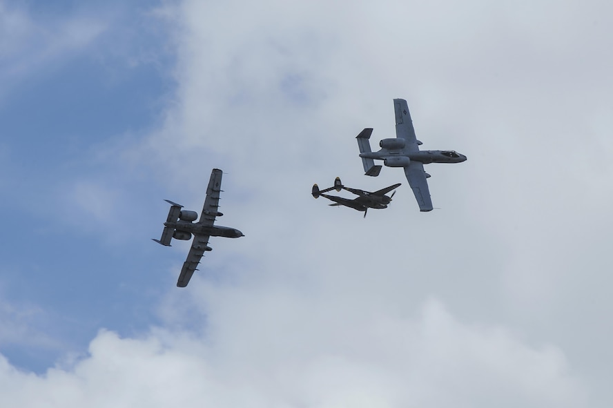Two U.S. Air Force A-10C Thunderbolt IIs, assigned to the 354th Fighter Squadron and a part of the A-10 West Heritage Flight Team, and a P-38 Lightning break away after flying in formation during the Los Angeles County Air Show in Lancaster, Calif., March 25, 2017. This is the team's first air show performance after nearly five years of disbandment. (U.S. Air Force photo by Airman 1st Class Mya M. Crosby)