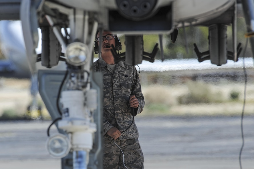 U.S. Air Force Senior Airman Jeff White, A-10 West Heritage Flight Team and 355th Maintenance Squadron crew chief, performs a pre-flight inspection during the Los Angeles County Air Show in Lancaster, Calif., March 26, 2017. The A-10 WHFT is scheduled to perform in 9 more air shows throughout the U.S. this year after resurging from a 5-year-long inactivation period. (U.S. Air Force photo by Airman 1st Class Mya M. Crosby)