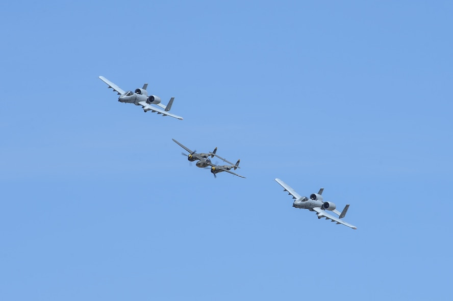 Two U.S. Air Force A-10C Thunderbolt IIs, assigned to the 354th Fighter Squadron and a part of the A-10 West Heritage Flight Team, and a P-38 Lightning fly in formation during the Los Angeles County Air Show in Lancaster, Calif., March 26, 2017. This is the team's first air show performance after nearly five years of disbandment. (U.S. Air Force photo by Airman 1st Class Mya M. Crosby)