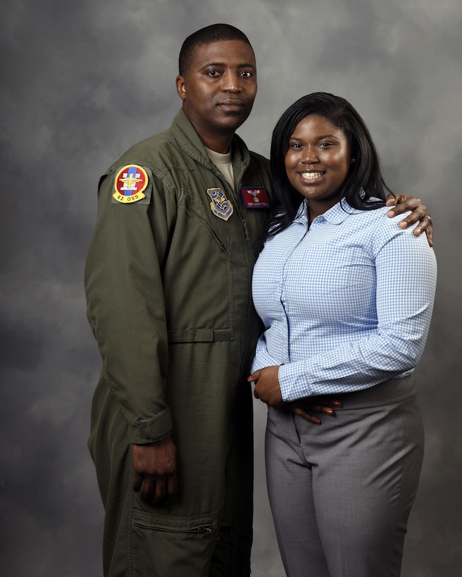 Tech. Sgt. Quincy Hall, 62nd Operations Support Squadron loadmaster, poses with his daughter, Nyah Hall, March 28, 2017 at Joint Base Lewis-McChord, Wash. Nyah, a sophomore at Clover Park High School who aspires to be an Air Force flight nurse, was named Washington State Military Youth of the Year during a Boys and Girls Club event, March 23, 2017 in Seattle. (U.S. Air Force photo/Staff Sgt. Whitney Amstutz)