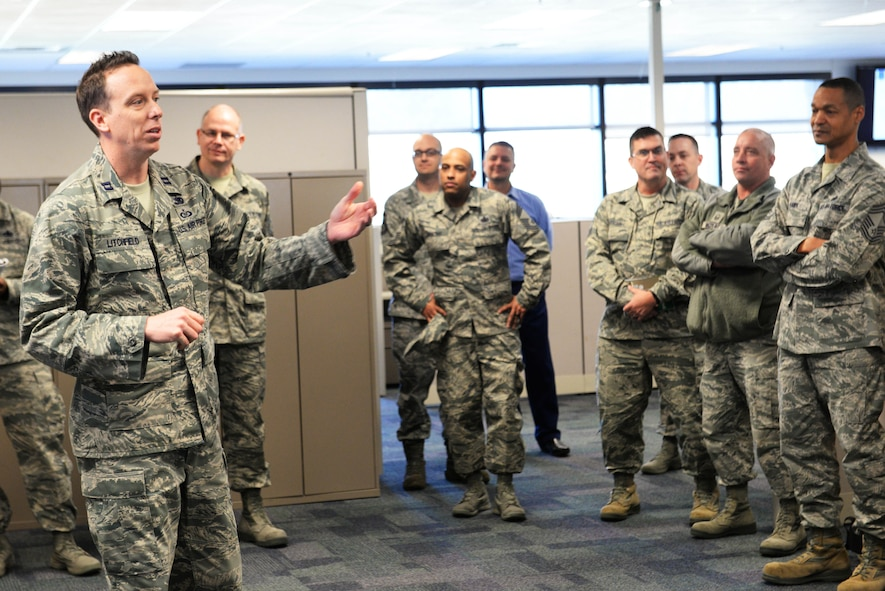 Capt. Chip Litchfield, 436th Supply Chain Operations Squadron operations officer, briefs senior ncos about using auto-sourcing as a way to get supplies to customers during a logistics readiness summit tour March 22 at Scott Air Force Base.  Auto-sourcing is a computer-generated tool that searches different locations for equipment and other supplies, in order to move them to where they are needed, and it is tailored to each location. (U.S. Air Force photo by Tech. Sgt. Maria Castle)