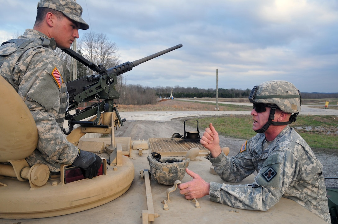 U.S. Army Reserve !st. Sgt. Ralph Class, 979th Mobility Augmentation Company, 478th Engineer Battalion, 926th Engineer Brigade, 412th Theater Engineer Command, based in Lexington, Ky., offers some advice to Spc. Johnny Jarreett before he and his crew leave the ammunition point and participate in a Gunnery crew live-fire qualification at Wilcox Range on Fort Knox, Ky., March 28, 2017. This is the first time that this company has fired its M2s and M240B Machine Guns from M113 Armored Personnel Carriers. This training ensures that Army Reserve units and Soldiers bring combat-ready and lethal firepower to worldwide operations. (U.S. Army Reserve Photo by Sgt. 1st Class Clinton Wood)