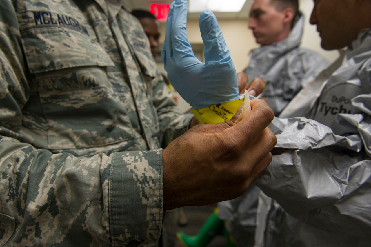 Airmen from the 779th Aerospace Medicine Squadron's bioenvironmental flight change into suits for handling hazardous material during a training exercise at Joint Base Andrews, Md., Jan.18, 2017. The flight conducts routine training to remain proficient and ready to respond at a moment's notice. Air Force photo by Senior Master Sgt. Adrian Cadiz