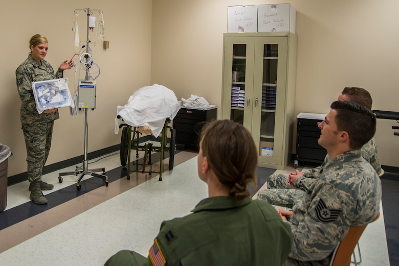 Tech. Sgt. Emily Irwin-Green, St. Louis Center for Sustainment of Trauma and Rediness Skills emergency and trauma nursing instructor, discusses the uses of various medical euipment during a C-STARS course in St. Louis Missiouri, March 20, 2017. Irwin-Green said her favorite part of the job is seeing the confidence in her students grow while providing them the skills needed to potentially save the lives of her brothers and sisters-in-arms. (U.S. Air Force Photo by Airman 1st Class Daniel Garcia)