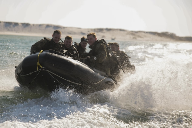 Marines with 3rd Force Reconnaissance Company ride aboard a combat rubber raiding craft toward an open water site during a ship-to-shore diving operation exercise at Pensacola, Fla., March 22, 2017. The exercise focused on performing sustainment training on Marine combative dive tactics. The training will enhance the company's capability conduct specialized insertion and extraction tasks. (U.S. Marine Corps photo by Sgt. Ian Ferro)