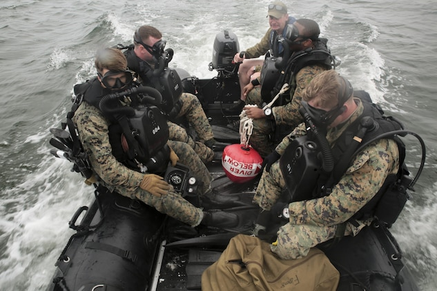 Marines with 3rd Force Reconnaissance Company ride aboard the combat rubber raiding craft toward an open water deployment during a ship-to-shore diving operation exercise at Pensacola, Fla., March 23, 2017. The exercise focused on performing sustainment training on Marine combative dive tactics. The training will enhance the company's capability conduct specialized insertion and extraction tasks. (U.S. Marine Corps photo by Sgt. Ian Ferro)