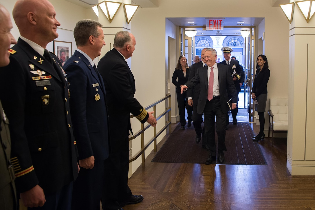 >Defense Secretary Jim Mattis greets commissioned officers.