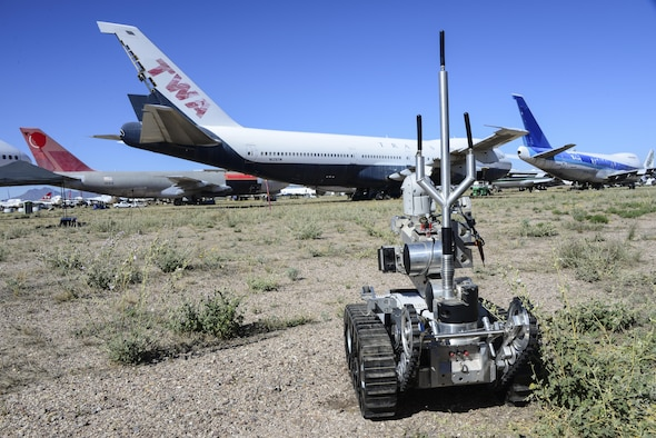 A U.S. Air Force Medium-Sized Robot prepares to approach an improvised explosive device during the Raven's Challenge XI Interoperability Exercise at Pinal Airpark in Marana, Ariz., March 21, 2017. Pinal Airpark is a commercial airliner scrapyard, which provides an optimal military training environment. (U.S. Air Force photo by Airman 1st Class Nathan H. Barbour)