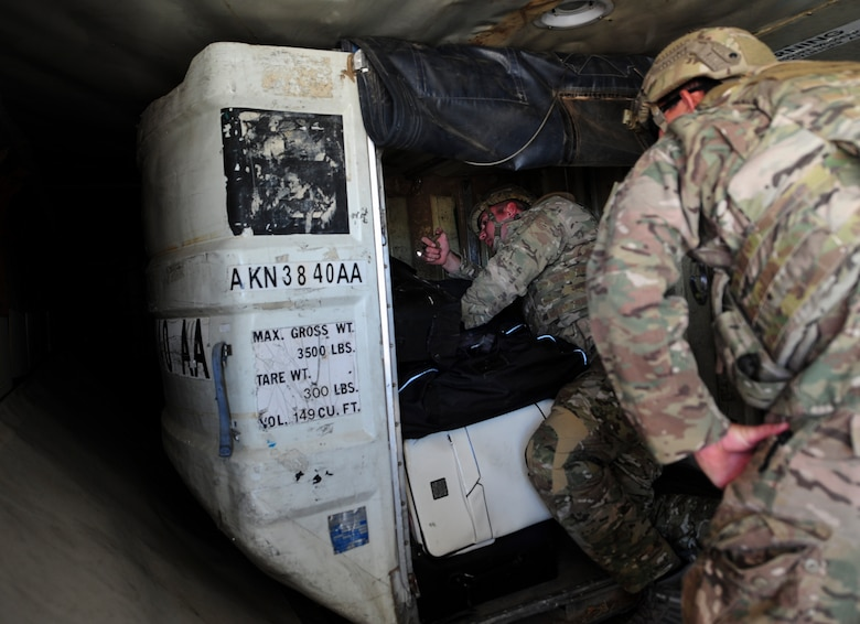 U.S. Airmen from the 355th Civil Engineer Squadron's Explosive Ordnance Disposal flight search for an improvised explosive device in the cargo hold of a large aircraft during the Raven's Challenge XI Interoperability Exercise at Pinal Airpark in Marana, Ariz., March 21, 2017. The main focus of the exercise was to utilize interagency tactics to counteract IEDs in realistic stateside and overseas operational scenarios. (U.S. Air Force photo by Airman 1st Class Nathan H. Barbour)