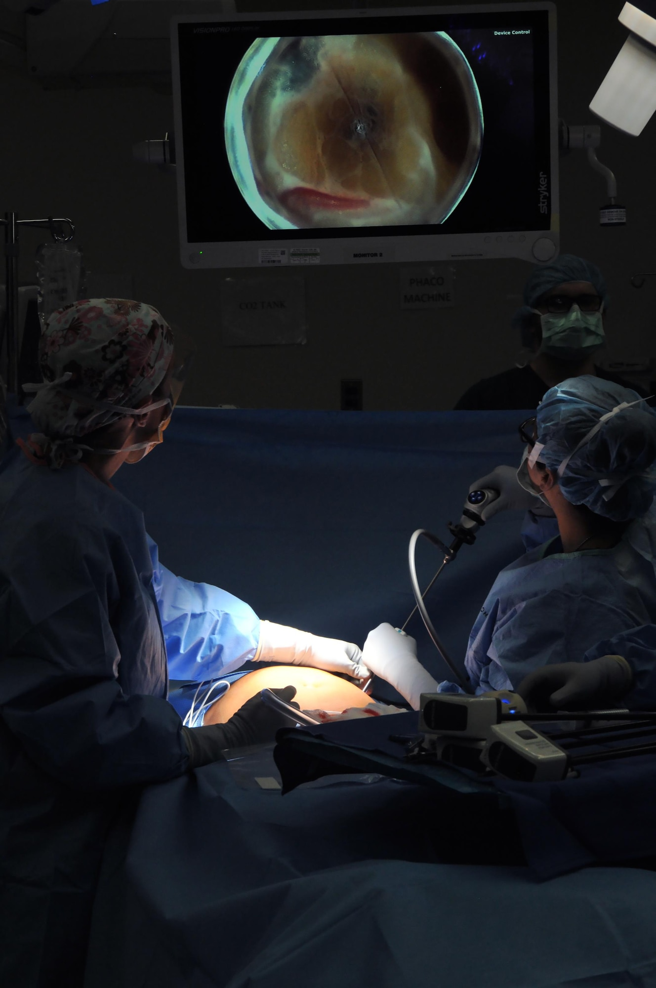 Maj. Lauren Buck, 81st Surgical Operations Squadron general surgeon, and a surgical technician perform a da Vinci ventral hernia repair, March 28, 2017, on Keesler Air Force Base, Miss. This was the first robotic surgery in the Air Force. The robotic system enhances surgeon's mobility and range of motion.(U.S. Air Force photo by Senior Airman Jenay Randolph)