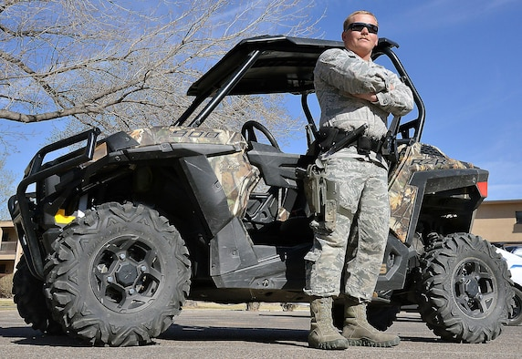 Senior Airman Jason Newsom, 377th Security Forces Squadron installation patrolman, stands with his Polaris RZR 900 EPS Razor at Kirtland March 21. SFS Airmen patrol the Kirtland fence line in remote areas using Razor all-terrain vehicles. (U.S. Air Force Photo/Senior Airman Chandler Baker)