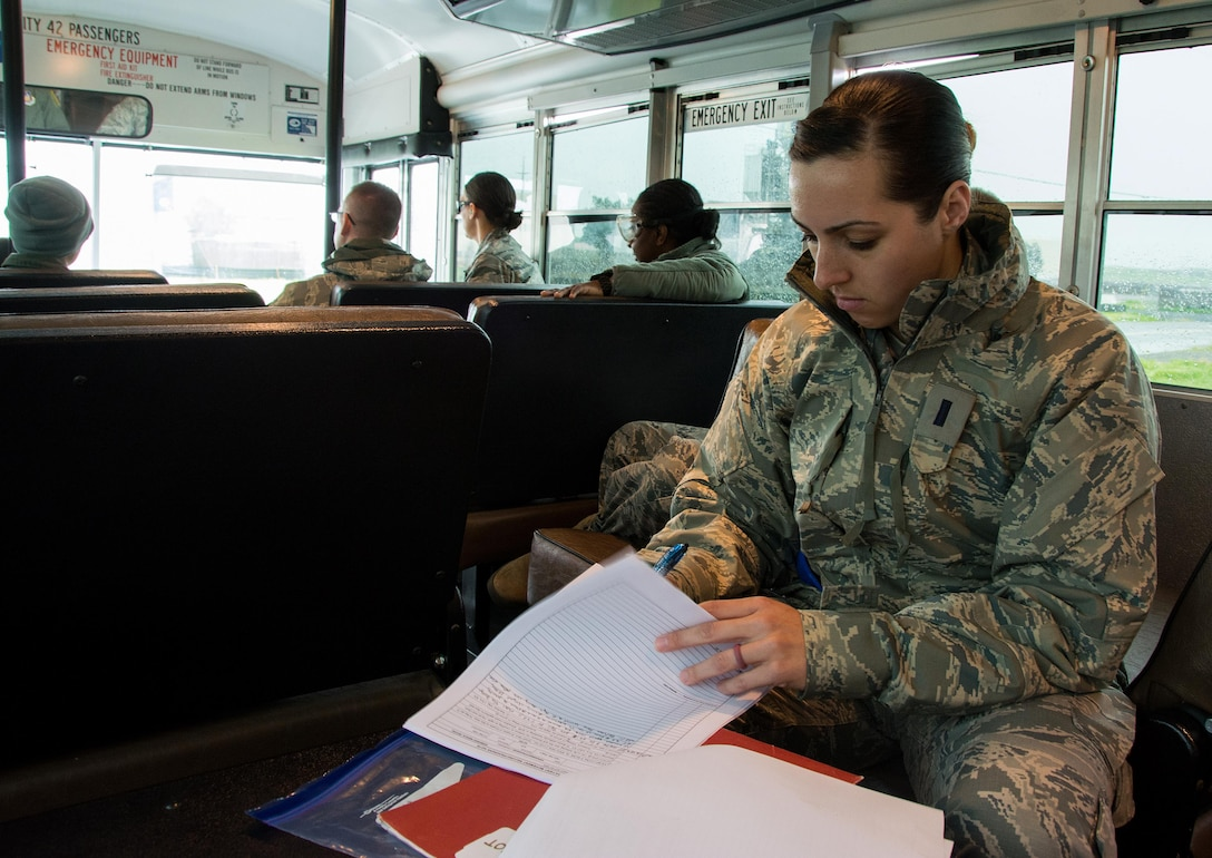 """1st Lt. Christine Aye, 60th Inpatient Squadron nurse, goes over a """"patient's"""" paper work during Patriot Delta at Travis Air Force Base, Calif. on March 24, 2017. Members of the 60th IPTS participated in the Air Force Reserve exercise Patriot Delta, providing enroute patient care and staging the medical manikins. (U.S. Air Force photo by Staff Sgt. Daniel Phelps)"""