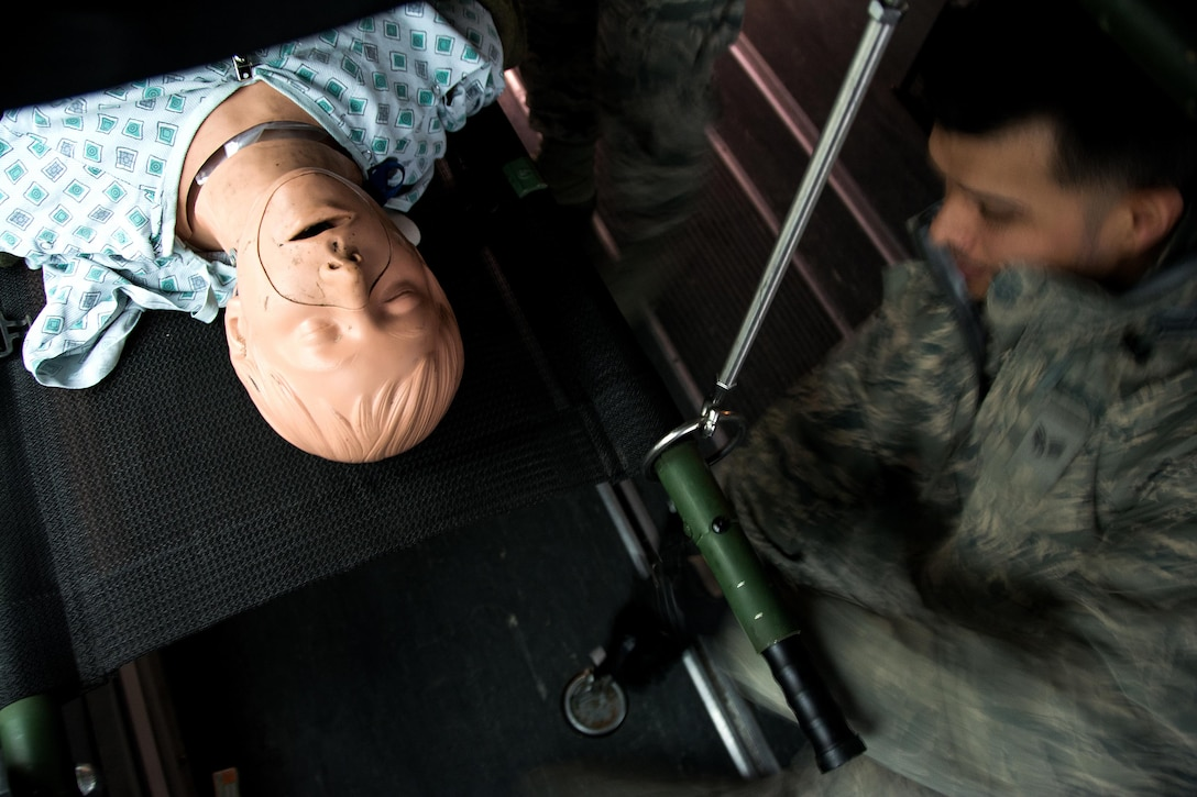 Senior Airman Juan Bermuda-Torres, 60th Inpatient Squadron medical technician, secures a medical manikin's litter on an ambulance bus at David Grant U.S. Air Force Medical Center at Travis Air Force Base, Calif., on March 24, 2017. Members of the 60th IPTS participated in the Air Force Reserve exercise Patriot Delta, providing enroute patient care and staging the medical manikins. (U.S. Air Force photo by Staff Sgt. Daniel Phelps)