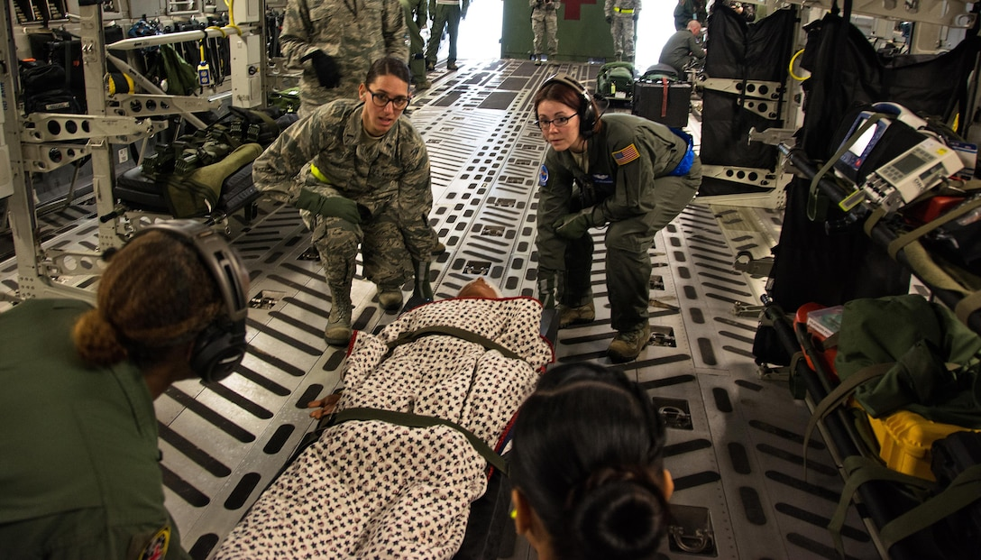 Patriot Delta participants carry a litter with a medical manikin patient onto a C-17 Globemaster III during Patriot Delta at Travis Air Force Base, Calif. on March 24, 2017. Patriot Delta brought in aeromedical evacuations squadrons from the from the 911th Airlift Wing at Pittsburgh Air Reserve Station, Penn., the 908th AW at Maxwell Air Force Base, Miss.; the 932d Airlift Wing at Scott AFB, Ill.; and the 349th Air Mobility Wing at Travis AFB. (U.S. Air Force photo by Staff Sgt. Daniel Phelps)