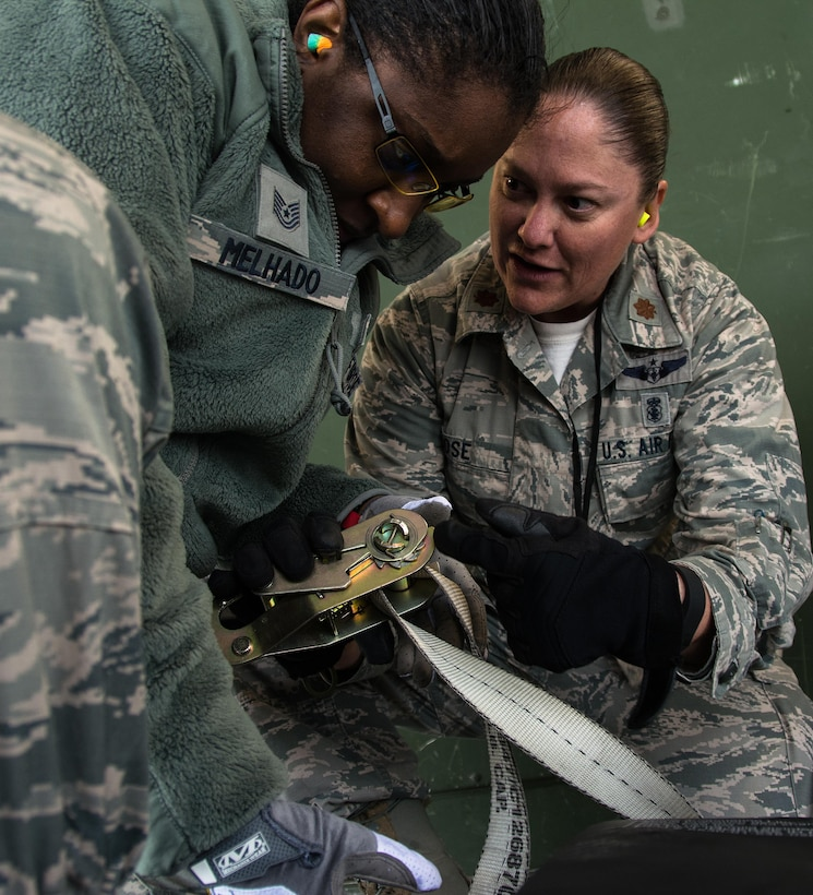 Maj. Kelly Rose, 349th Aeromedical Evacuation Squadron operations flight commander, instructs Tech. Sgt. Anna Melhado, 60th Inpatient Squadron medical technician, on how to properly secure a litter onto an aircraft during Patriot Delta at Travis Air Force Base, Calif. on March 24, 2017.  Members of the 60th IPTS participated in the Air Force Reserve exercise Patriot Delta, providing enroute patient care and staging the medical manikins. (U.S. Air Force photo by Staff Sgt. Daniel Phelps)