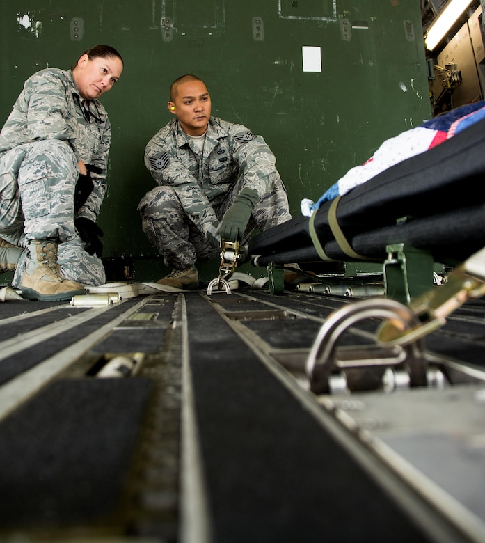 Maj. Kelly Rose, 349th Aeromedical Evacuation Squadron operations flight commander, instructs Tech. Sgt. Richard Manutag, 312th Airlift Squadron operations technician, on how to properly secure a litter onto an aircraft during Patriot Delta at Travis Air Force Base, Calif. on March 24, 2017.  Patriot Delta brought in aeromedical evacuations squadrons from the from the 911th Airlift Wing at Pittsburgh Air Reserve Station, Penn., the 908th AW at Maxwell Air Force Base, Miss.; the 932d Airlift Wing at Scott AFB, Ill.; and the 349th Air Mobility Wing at Travis AFB. (U.S. Air Force photo by Staff Sgt. Daniel Phelps)