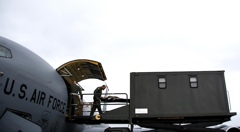 Master Sgt. Rard Perkins, 911th Operations Group aircrew trainer, offloads a patient onto a specialized medical K loader during Patriot Delta at Travis Air Force Base, Calif. on March 24, 2017. Patriot Delta brought in aeromedical evacuations squadrons from the from the 911th Airlift Wing at Pittsburgh Air Reserve Station, Penn., the 908th AW at Maxwell Air Force Base, Miss.; the 932d Airlift Wing at Scott AFB, Ill.; and the 349th Air Mobility Wing at Travis AFB. (U.S. Air Force photo by Staff Sgt. Daniel Phelps)
