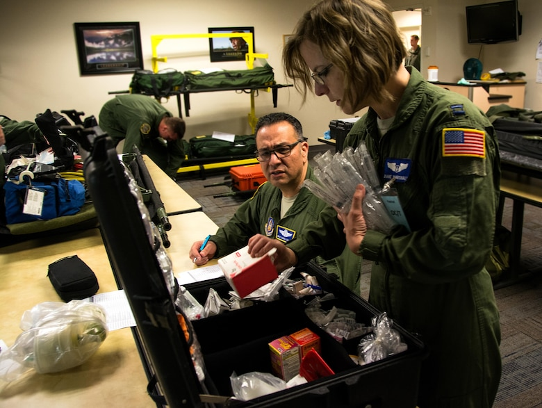 Senior Master Sgt. Gabriel Aguilar, 349th Aeromedical Evacuation Squadron superintendent of nursing services, and Capt. Diane Marshall, 932nd Aeromedical Evacuation Squadron flight nurse, perform inventory on medical equipment during Patriot Delta at Travis Air Force Base, Calif. on March 24, 2017. Patriot Delta brought in aeromedical evacuations squadrons from the from the 911th Airlift Wing at Pittsburgh Air Reserve Station, Penn., the 908th AW at Maxwell Air Force Base, Miss.; the 932d Airlift Wing at Scott AFB, Ill.; and the 349th Air Mobility Wing at Travis AFB. (U.S. Air Force photo by Staff Sgt. Daniel Phelps)