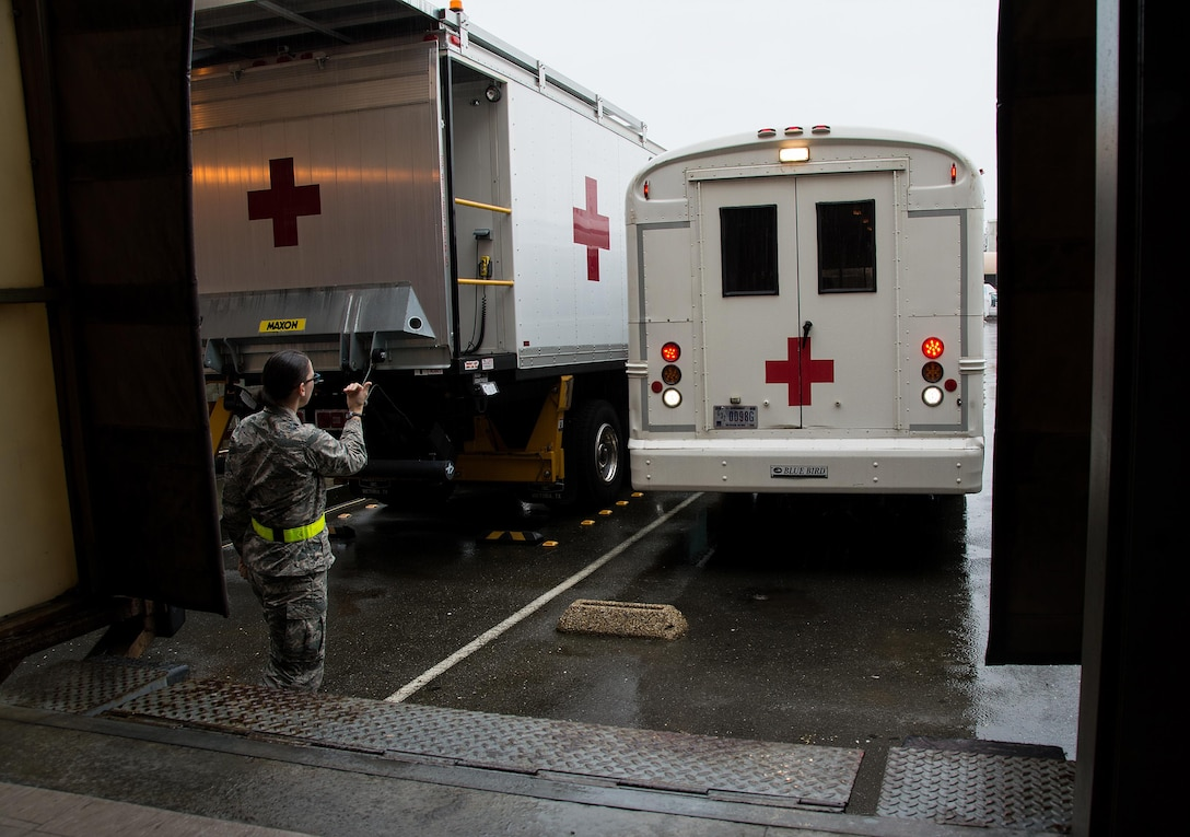 1st Lt. Andrea Nofi, 60th Inpatient Squadron nurse, guides an ambulance bus to the edge of a loading dock at David Grant U.S. Air Force Medical Center at Travis Air Force Base, Calif., on March 24, 2017. Members of the 60th IPTS participated in the Air Force Reserve exercise Patriot Delta, providing enroute patient care. (U.S. Air Force photo by Staff Sgt. Daniel Phelps)