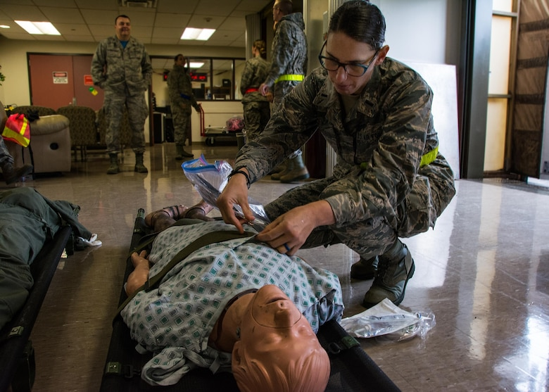 1st Lt. Andrea Nofi, 60th Inpatient Squadron nurse, stages a medical manikin at David Grant U.S. Air Force Medical Center at Travis Air Force Base, Calif., on March 24, 2017. Members of the 60th IPTS participated in the Air Force Reserve exercise Patriot Delta, providing enroute patient care and staging the medical manikins. (U.S. Air Force photo by Staff Sgt. Daniel Phelps)