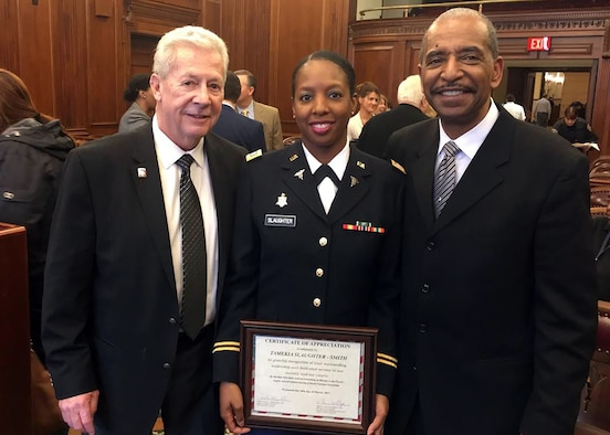 In honor of Women's History Month Capt. Nikki Slaughter-Smith, 328th Combat and Operational Stress Control, Army Reserve, was recognized along with several other prominent women during a special ceremony at the Buffalo N.Y. Veterans Court March 28, 2017.  She was recognized for her outstanding leadership and dedicated service to our country and our courts as a part-time Soldier, full-time Citizen Airman social worker with the 914th Airlift Wing, Air Force Reserve, and volunteer Veterans Court Mentor.  Pictured with Capt. Slaughter-Smith is Robert T. Russell, Veterans Treatment Court Judge (right), and Jack O'Connor, Veterans Court Mentor Coordinator.  (Courtesy photo)