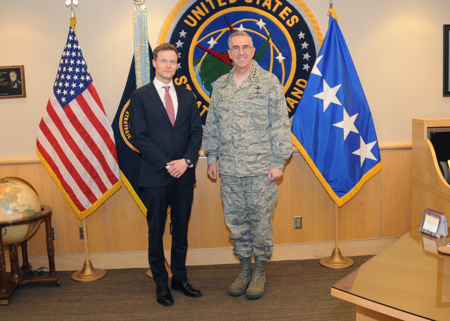 """U.S. Air Force Gen. John E. Hyten (right), commander of U.S. Strategic Command (USSTRATCOM), welcomes Dr. Matthew Kroenig, associate professor in the Department of Government and School of Foreign Service at Georgetown University and a senior fellow in the Brent Scowcroft Center on International Security at The Atlantic Council, to USSTRATCOM headquarters, Offutt Air Force base, Neb., March 29, 2017. While here, Kroenig held discussions with Hyten and delivered a presentation to command members on """"The Logic of American Nuclear Strategy."""" In his remarks, Dr. Kroenig discussed the advantages and disadvantages of nuclear superiority; his perspective of nonproliferation; the results of hypothetical nuclear conflicts and crises; and other topics related to global nuclear capabilities. Georgetown University is one of more than 30 local and national academic institutions that make up the Deterrence and Assurance Academic Alliance – an organization that was started in Oct. 2014 to stimulate new thinking and develop future generations of deterrence practitioners. One of nine Department of Defense unified combatant commands, USSTRATCOM has global strategic missions assigned through the Unified Command Plan that include strategic deterrence; space operations; cyberspace operations; joint electronic warfare; global strike; missile defense; intelligence, surveillance and reconnaissance; and analysis and targeting."""