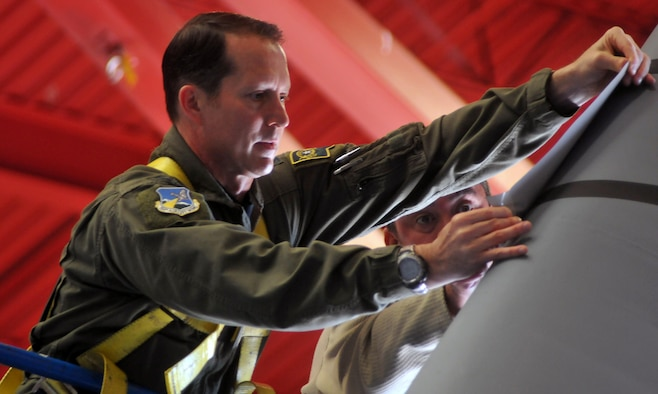 Col. Karl Stark applies a new tail flash to a 152nd Airlift Wing C-130 aircraft in 2015. Stark's three-year tenure as commander of the 152nd Airlift Wing comes to a close this weekend as he passes command to Col. Eric Wade.
