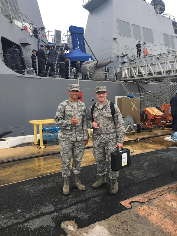 U.S. Air Force Senior Airman Raphy Feolino and Airman 1st Class Derrik Fleton, bioenvironmental engineering technicians, supported the Navy Environmental and Preventative Medicine Unit 6 by conducting ventilation surveys aboard the Preble.  (Courtesy Photo)