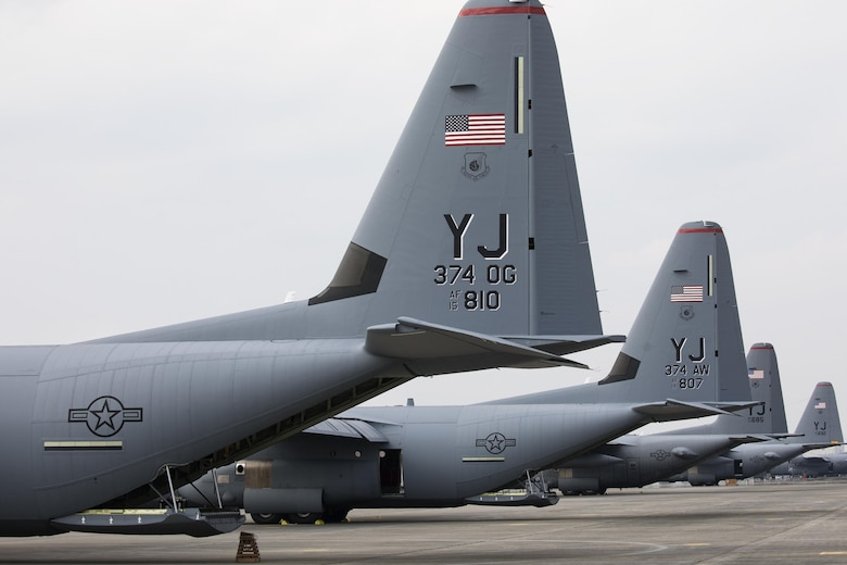 Two C-130J Super Hercules and two C-130H Hercules aircraft sit on the flightline at Yokota Air Base, Japan, March 29, 2017. Yokota is the only forward-based tactical airlift squadron in the Pacific region. They provide C-130 aircrews to conduct theater airlift, special operations, aeromedical evacuation, repatriation and humanitarian relief missions. (U.S. Air Force photo by Yasuo Osakabe)