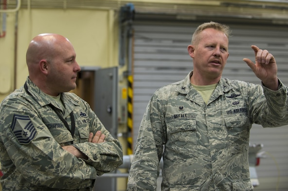 """U.S. Air Force Col. Joseph McFall, 52nd Fighter Wing commander, speaks with Airmen from the 52nd Maintenance Squadron munitions section about the impact munitions have when piloting an F-16 Fighting Falcon during a Saber leadership """"out and about"""" event at Spangdahlem Air Base, Germany, March 27, 2017. The 52nd MXS offered the hands on experience to Wing leadership to help them better understand the full spectrum of munitions building training. (U.S. Air Force photo by Senior Airman Dawn M. Weber)"""