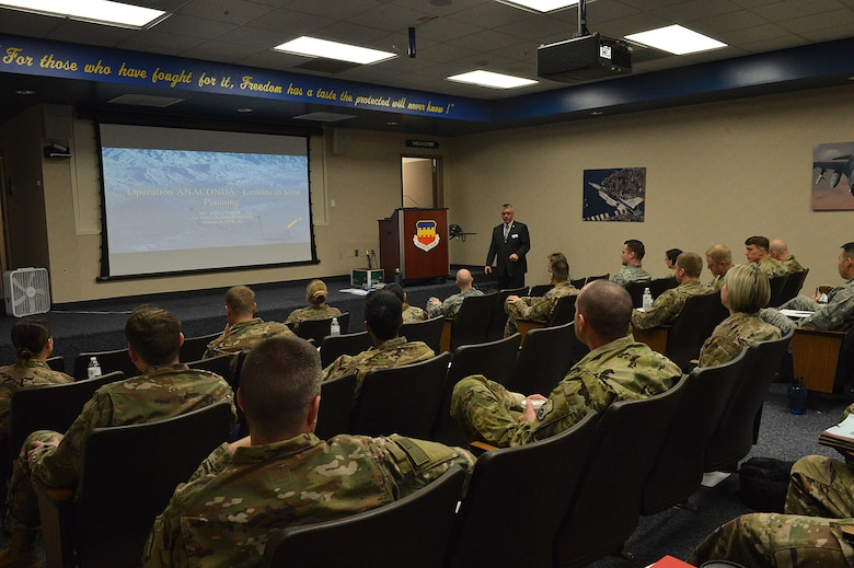 An instructor from Air University's LeMay Center begins a lesson with Rear Mission Support Element course students at Shaw Air Force Base, S.C., Feb. 21, 2017. The four-week course provides two weeks of in-class instruction on military doctrine, joint operation planning, course of action development and OIR specific products. (U.S. Air Force photo by Senior Airman Diana M. Cossaboom)