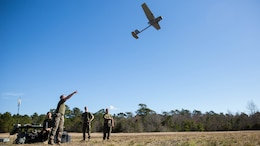 A Marine launches a Raven small unmanned aircraft system into the air at Marine Corps Base Camp Lejeune, N.C., March 27, 2017. Marines conducted aerial training exercises at Tactical Landing Zone Dove to demonstrate the capabilities and build familiarization with the SUAS. The Marines are intelligence specialists with 2nd Battalion, 8th Marine Regiment.