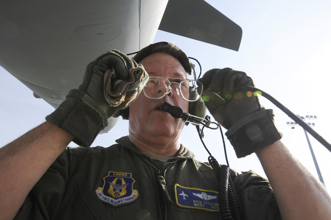 Master Sgt. Richard Titcomb, 339th Flight Test Squadron C-5 flight engineer, readjusts his glasses while performing pre-flight checks to a C-5M Super Galaxy March 29, 2017, at Robins Air Force Base, Ga. Titcomb has been with the squadron for nearly two years. (U.S. Air Force photo by Jamal D. Sutter)
