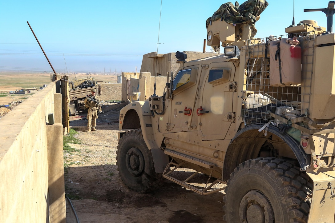 U.S. Army Paratroopers, deployed in support of Combined Joint Task Force-Operation Inherent Resolve and assigned to 2nd Brigade Combat Team, 82nd Airborne Division, park a tactical vehicle during a resupply convoy near Al Tarab, Iraq, during the offensive to liberate West Mosul from ISIS, March 27, 2017. The 2nd BCT, 82nd Abn. Div., enables their Iraqi security forces partners through the advise and assist mission, contributing planning, intelligence collection and analysis, force protection, and precision fires to achieve the military defeat of ISIS. CJTF-OIR is the global Coalition to defeat ISIS in Iraq and Syria. (U.S. Army photo by Staff Sgt. Jason Hull)