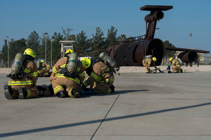 Firefighters with the 39th Civil Engineer Squadron, work together to aid multiple simulated aircraft accident victims during a major accident response exercise (MARE) March 29, 2017, at Incirlik Air Base, Turkey. A MARE is designed to test an installation's ability to respond to different events that could negatively impact the mission. (U.S. Air Force photo by Airman 1st Class Devin M. Rumbaugh)