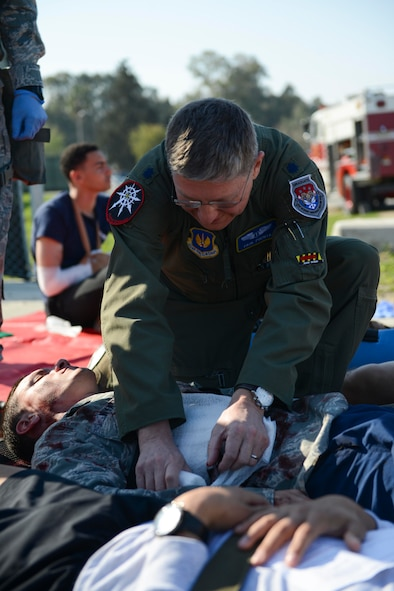 U.S. Air Force Lt. Col. Paul Puchta, 39th Medical Group chief of aerospace medicine, aids a simulated aircraft accident victim during a major accident response exercise (MARE) March 29, 2017, at Incirlik Air Base, Turkey. During a MARE, all simulated medical injuries and victims are treated as if they are real by firefighters and medical personnel.  (U.S. Air Force photo by Airman 1st Class Devin M. Rumbaugh)